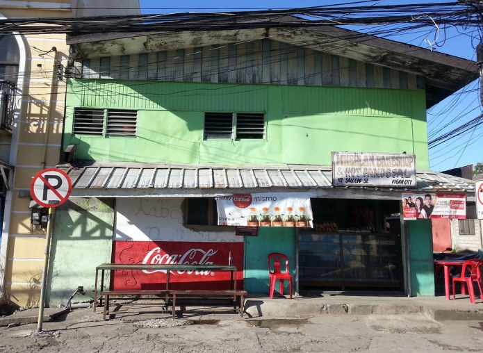 coca cola store in Vigan with No Parking sign