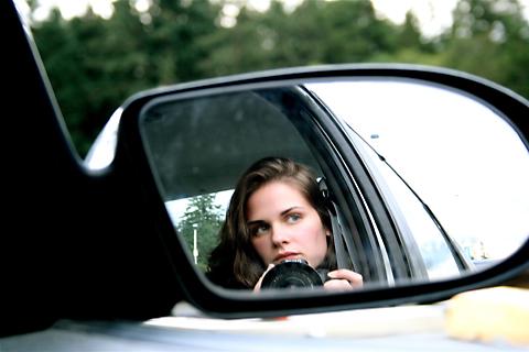 lisa in rear car view window