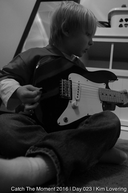 Henry with his black electric guitar