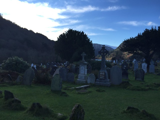 Part of the Glendalough cemetery, with the lakes in the background
