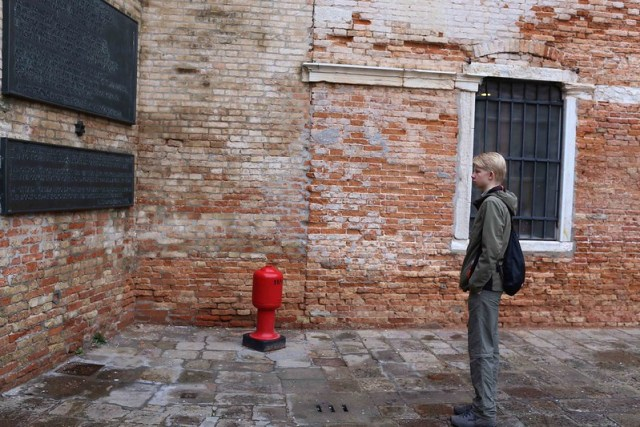 The Portrait of a Young Man Looking On At The Inscription Commemorating the Jews of Venice Who Died in The Nazi Camps