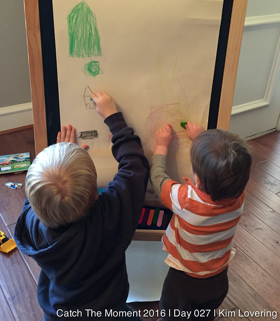 Henry and Jonah coloring at an easel toghether