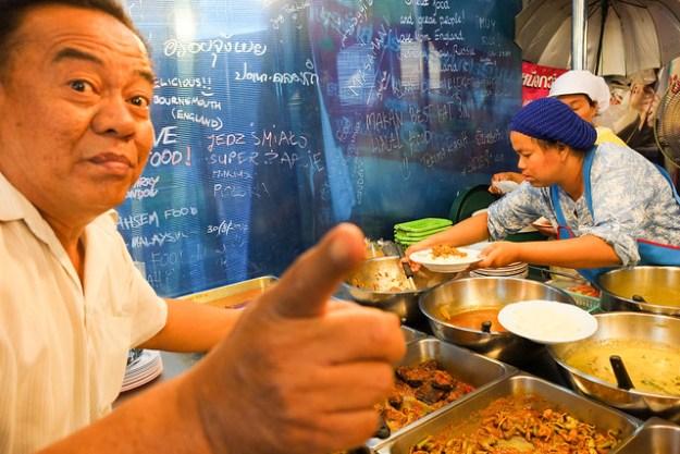 Vendor of spicy Thai food. Night market, Krabi