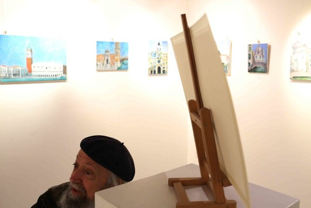 City Moment - The Artist Sits Beside His Biography, Venice Ghetto