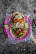 Tacos Memo | Carne asada topped with nopal (cactus) and potato, and of course you can't forget to add the salsa roja.