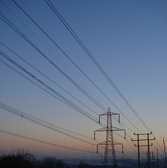 Electricity pylons in a winter landscape