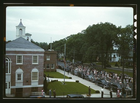 An American town and its way of life, Southington, Conn. The Memorial Day parade moving down the main street. The small number of spectators is accounted for by the fact that the town's war factories did not close. The town hall is in the left foreground.