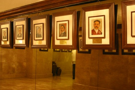 Portraits of dead heroes line up a wall of Heroes Hall. Do you recognize them?