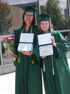 recent college graduates holding diplomas