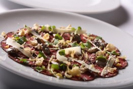 beef carpaccio, roast garlic and horseradish crema, baby oyster mushrooms