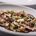 beef carpaccio, roast garlic and horseradish crema, baby oyster mushrooms