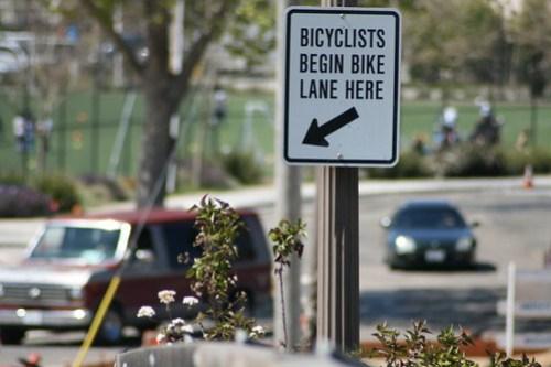 Bicyclists begin bike lane here