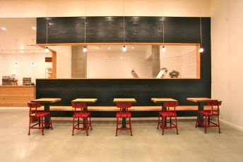 Five deuces facing the toasted wood-clad bakery/kitchen