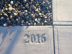 2016 stamp on West 1st Ave.