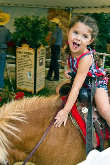 petting her pony