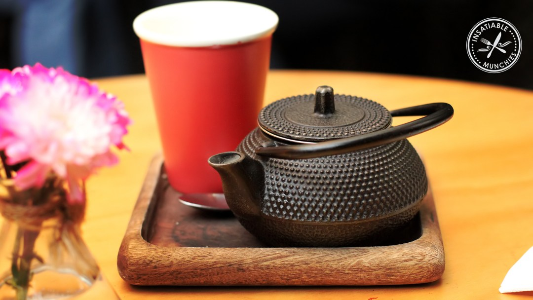 Chai tea served in a traditional iron tea pot