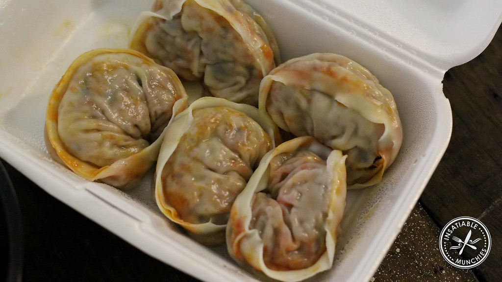 Kimchi mandoo, filled with kimchi, pork mince and noodles.