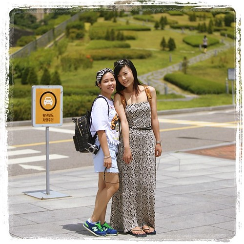 The matter how far we got into the campus, Chinese tourists were still legion. These two young ladies were walking through campus and more than happy to have their pictures taken by a street fashion photography crew.