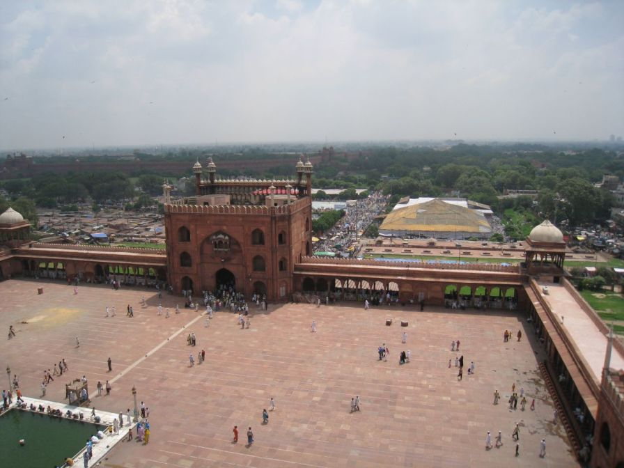 A view toward the main gate of Jama Masjid from atop a minaret, with Delhi's Red Fort in the distance.