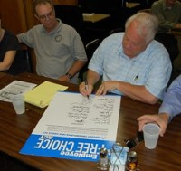 WI: State Senator Bob Jauch Signs the Employee...