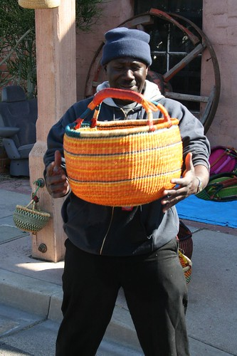 Abdullah shows his baskets for sale
