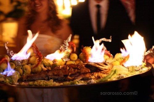 Flaming Roasted Sea Bass Fish at a Wedding in Sicily, Italy