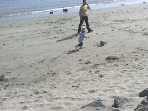 Mason playing soccer at the beach