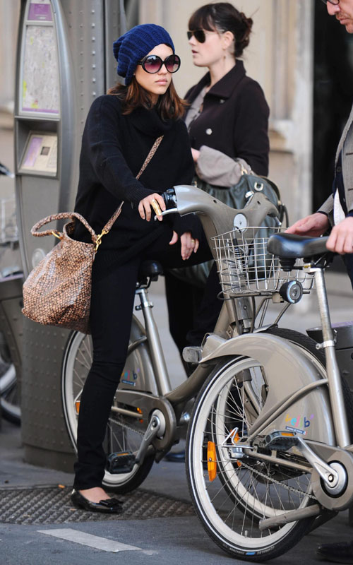 Jessica Alba riding a Velib rental bike in Paris, France