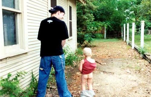 little girl pees outside