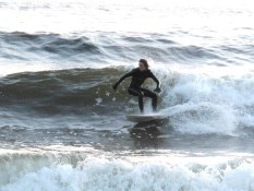 Surfer cutting backside, Mackenzie Beach