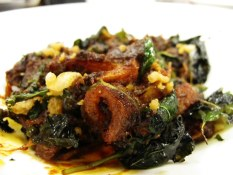 Crispy pork belly with grachai, red curry paste, and thai basil