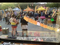 View of the night market from inside the Tin Can Studio