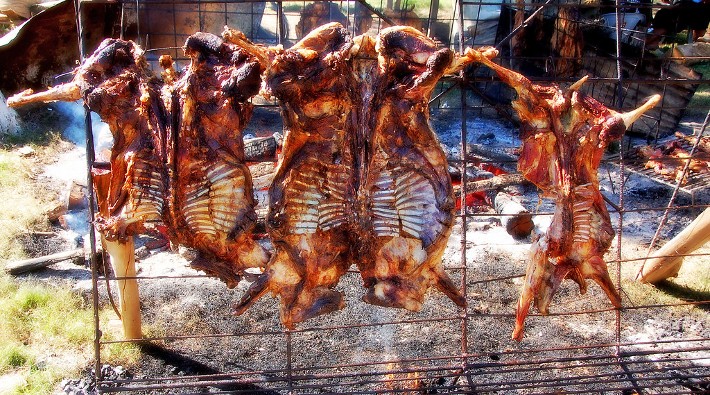 Whole animals are butterflied and slow barbecued over low flames and smoke