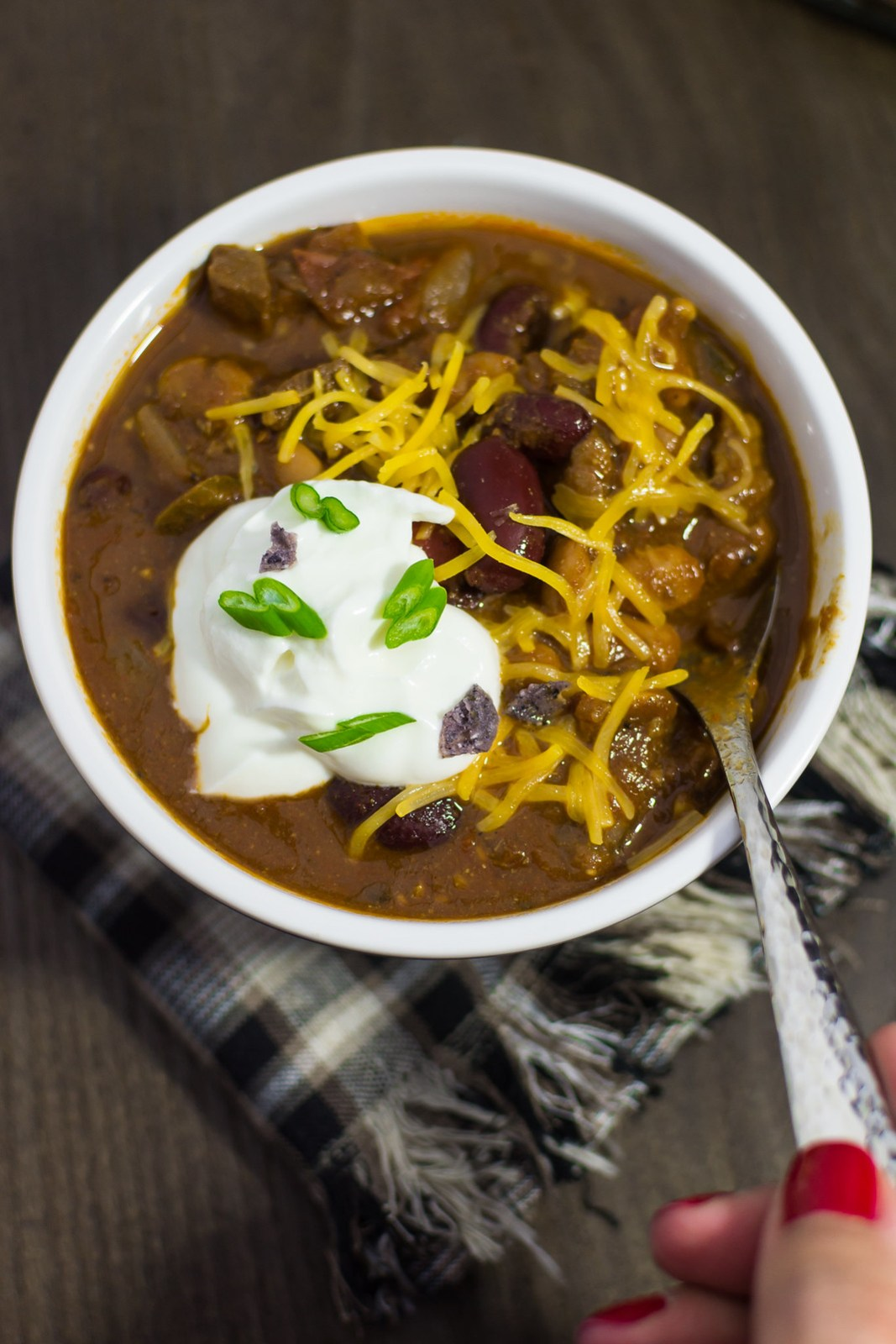 Smoky Homestyle Chili Final Close up with Hand_
