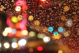 Downtown Lights Through Rain Speckled Windshield
