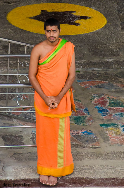 The temple priest in saffron robes