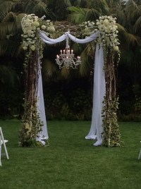 santa barbara style decorated wedding arch