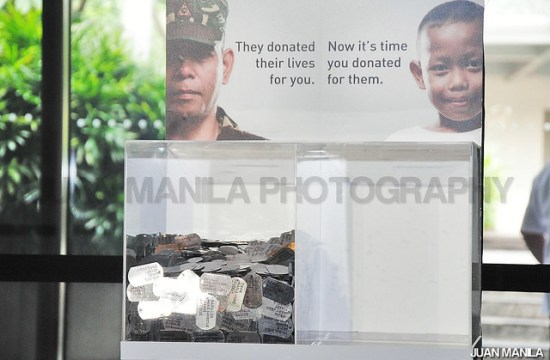 The HERO Donation Box with the symbolic dog-tags and the photos of a fallen soldier and poster boy Jon-Jon Tambong.