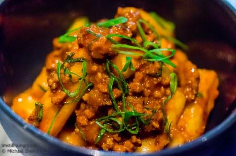 Momofuku Seiobo Spicy roasted rice cakes w/pork mince