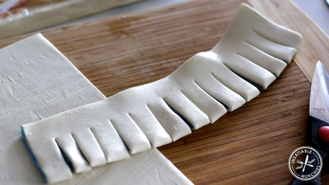 Using scissors, make cuts into the folded side of the pastry.