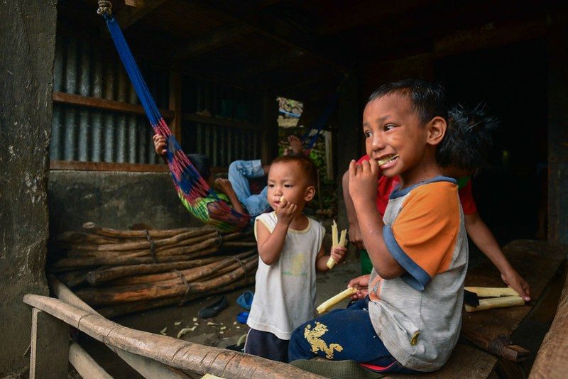 Kids of Buscalan munch on sugar cane, their equivalent of candy.