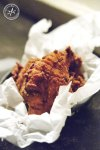 Mary's serves up Southern style fried chicken in an oval basket, couched in baking paper.