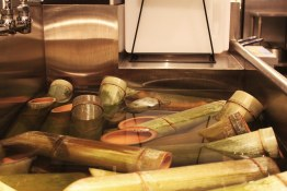 Bamboo sake sleeves soaking   Hapa Izakaya   Scout Magazine