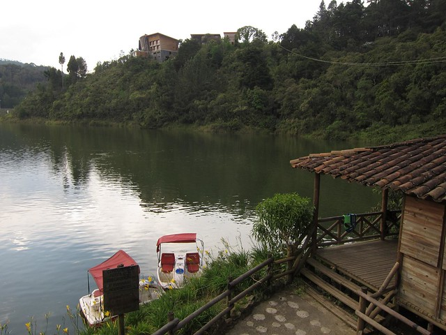 View of the lake, with the park's hotel perched on a hill above.