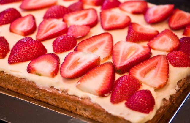 Strawberry Cake topped with Sweet Vanilla Mascarpone and sliced Strawberries