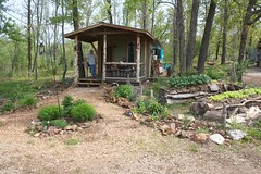 Early spring garden and cabin