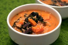 red curry soup with purple kale and rice