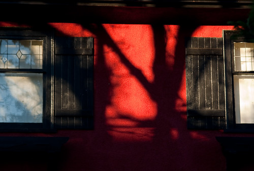 Red house and tree shadows