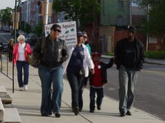 Edith Gilliard walking up Gilmor Street on the West Baltimore Squares Spring Walk