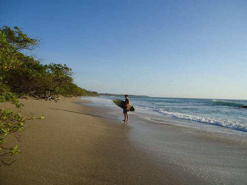 Surfer at Playa Langosta, Tamarindo